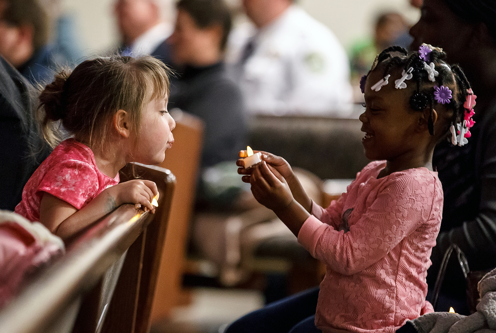 Anastasia McFarland, 4, left, and Journi Bowen, 5, right, play with a battery powered candle as they wait for the Building a Bridge of Respect event at the Union Baptist Church, Tuesday, Nov. 25, 2014, in Springfield. Justin L. Fowler/The State Journal-Register