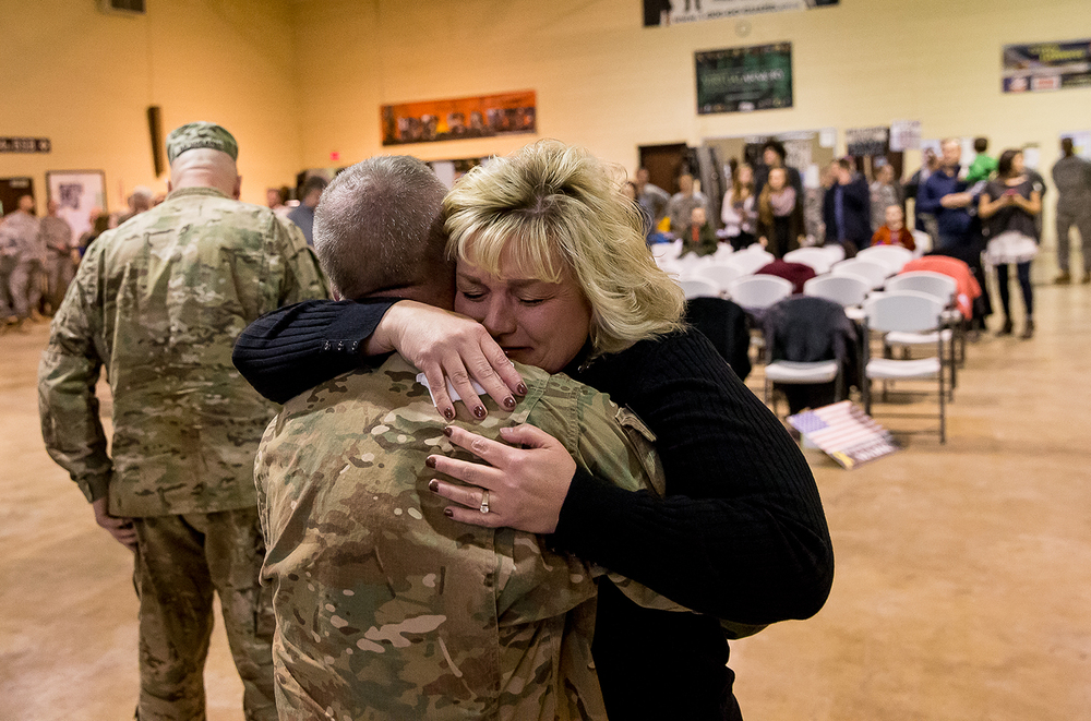 Lara LeGrand, of Galena, Ill., embraces her husband Lt. Col. Loren LeGrand as she sees him for the first time during a homecoming ceremony for the Illinois Army National Guard's Bilateral Embedded Staff Team (BEST) A13 at Camp Lincoln, Friday, Dec. 19, 2014, in Springfield. Justin L. Fowler/The State Journal-Register