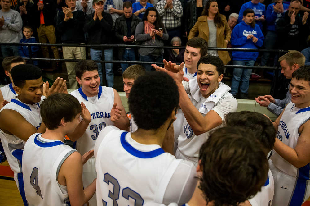 The Lutheran Crusaders begin to celebrate after defeating Athens 67-52 in the championship game of the 64th annual Waverly Holiday Tournament at Waverly Grade School, Tuesday, Dec. 30, 2014, in Waverly , Ill. Justin L. Fowler/The State Journal-Register