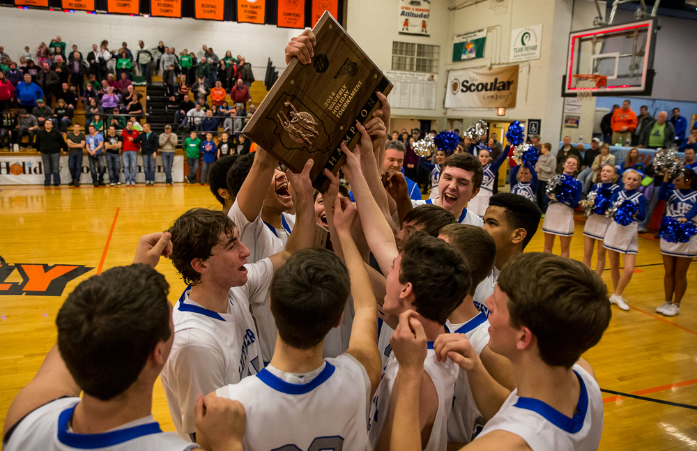 The Lutheran Crusaders celebrate with the trophy after defeating Athens 67-52 in the championship game of the 64th annual Waverly Holiday Tournament at Waverly Grade School, Tuesday, Dec. 30, 2014, in Waverly , Ill. Justin L. Fowler/The State Journal-Register