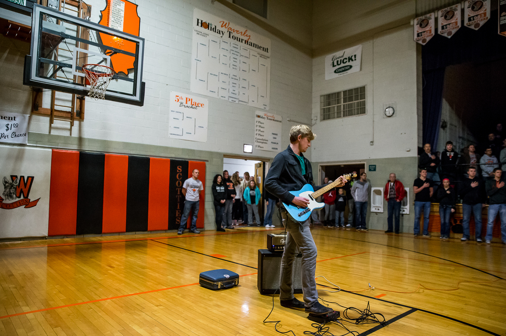 Waverly senior Zack Fedor plays the National Anthem on an electric guitar prior to Athens taking on Lutheran in the championship game of the 64th annual Waverly Holiday Tournament at Waverly Grade School, Tuesday, Dec. 30, 2014, in Waverly , Ill. Justin L. Fowler/The State Journal-Register