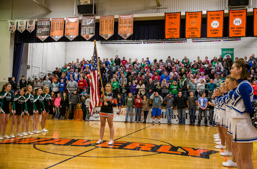 Waverly junior cheerleader Alyssa Legg holds the American flag as the National Anthem is getting set to be played for the championship game of the 64th annual Waverly Holiday Tournament at Waverly Grade School, Tuesday, Dec. 30, 2014, in Waverly , Ill. Justin L. Fowler/The State Journal-Register