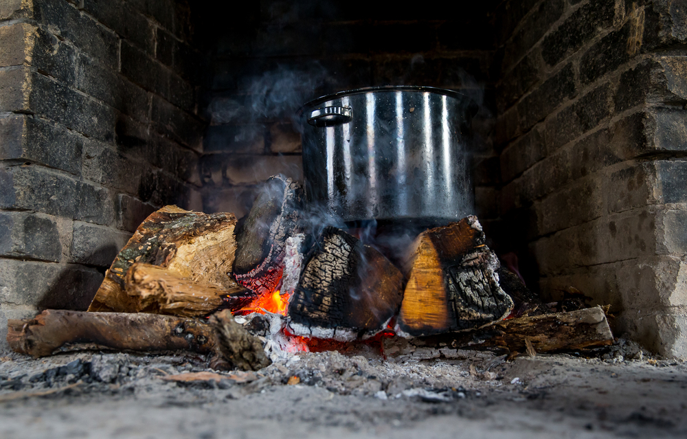 The stone soup is cooked over a wood fire during the Sangamon Valley Group of the Sierra Club's Stone Soup Hike at Carpenter Park, Thursday, Jan. 1, 2015, in Springfield, Ill. A pot for vegetarian soup and a pot for meat soup are simmered over of the fires while the participants go on a hike through Carpenter Park. Justin L. Fowler/The State Journal-Register