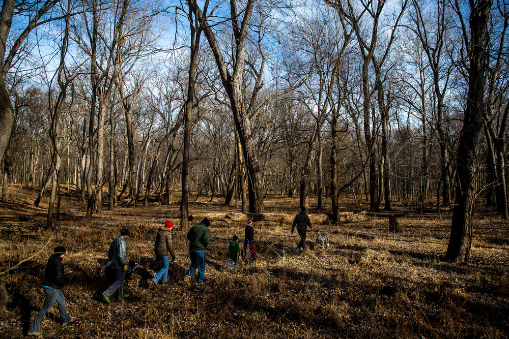 Bill Crook, along with his dog Bruno, leads a hiking group as they make their way towards the Sangamon River during the Sangamon Valley Group of the Sierra Club's Stone Soup Hike at Carpenter Park, Thursday, Jan. 1, 2015, in Springfield, Ill. Justin L. Fowler/The State Journal-Register