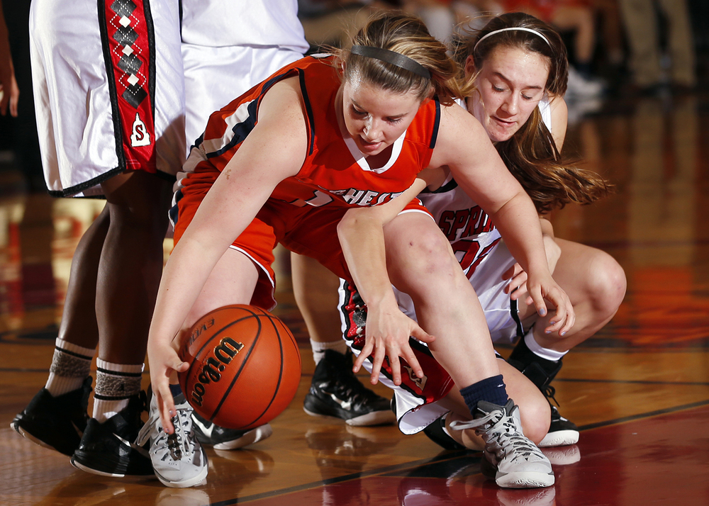 Rochester's Kylie Clemens grabs a loose ball at Springfield High School Saturday, Jan. 3, 2015. Ted Schurter/The State Journal-Register