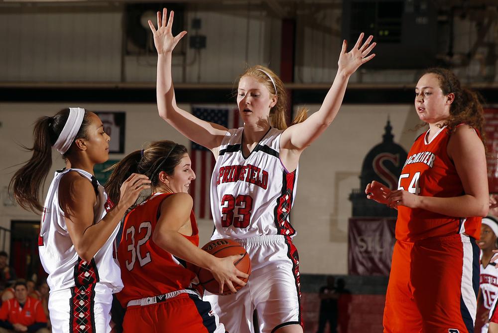Springfield's Ellie Brandt pressures Rochester's Laryn Sapetti at Springfield High School Saturday, Jan. 3, 2015. Ted Schurter/The State Journal-Register