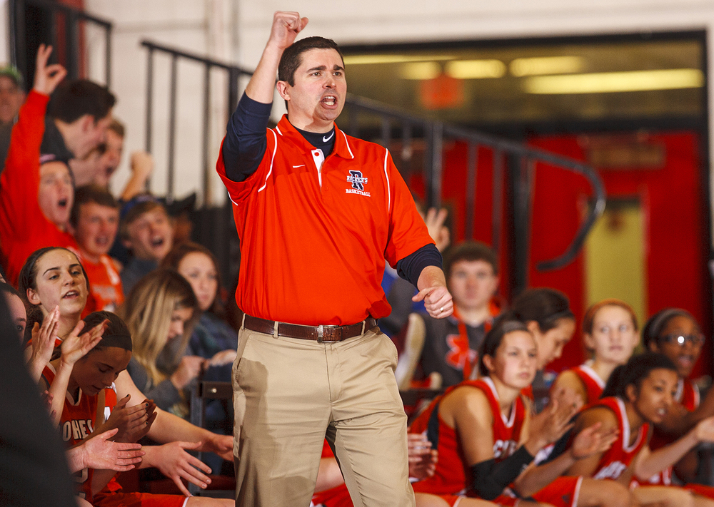 Rochester head coach J.R. Boudouris and the Rockets are pumped as they beat Springfield at Springfield High School Saturday, Jan. 3, 2015. Ted Schurter/The State Journal-Register