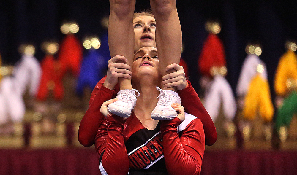 Competing in the small varsity division, members of the Bunker Hill High School cheerleading squad support a fellow team member during their routine on Saturday. The 31st Annual Illinois Cheerleading Coaches Association Championships kicked off a two-day run on Saturday, Jan. 3, 2014 at Springfield's Prairie Capital Convention Center. David Spencer/The State Journal-Register