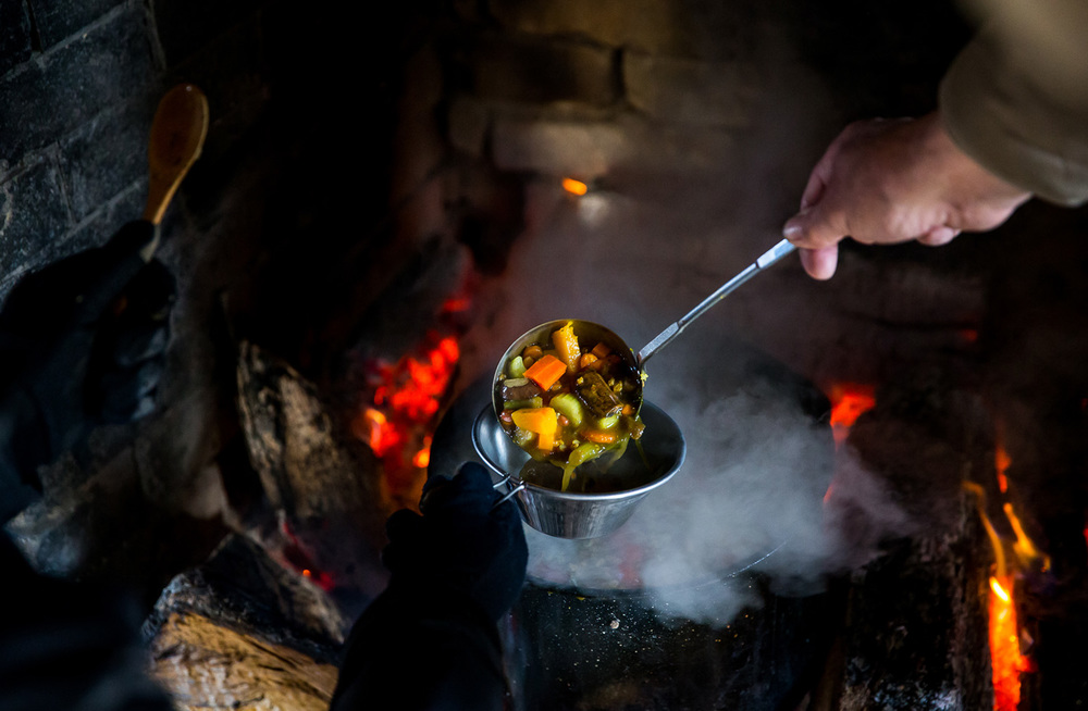 The stone soup is served up to the participants after the hike during the Sangamon Valley Group of the Sierra Club's Stone Soup Hike at Carpenter Park, Thursday, Jan. 1, 2015, in Springfield, Ill. Justin L. Fowler/The State Journal-Register