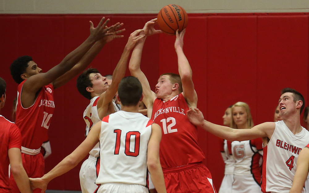 Jacksonville player Brandon McCombs looks to pass the ball under heavy pressure from Titan defenders Tuesday evening. Chatham Glenwood High School defeated Jacksonville High School 36-35 in boys basketball action at Glenwood High School Tuesday evening, Jan. 6, 2015. David Spencer/The State Journal-Register