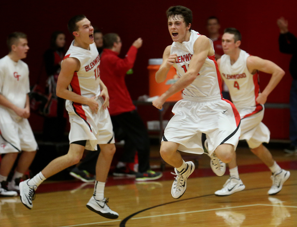 Glenwood player Nick Hammond at center jumps for joy along with teammate Cole Harper at far left after Harper made the game winning basket. Chatham Glenwood High School defeated Jacksonville High School 36-35 in boys basketball action at Glenwood High School Tuesday evening, Jan. 6, 2015. David Spencer/The State Journal-Register