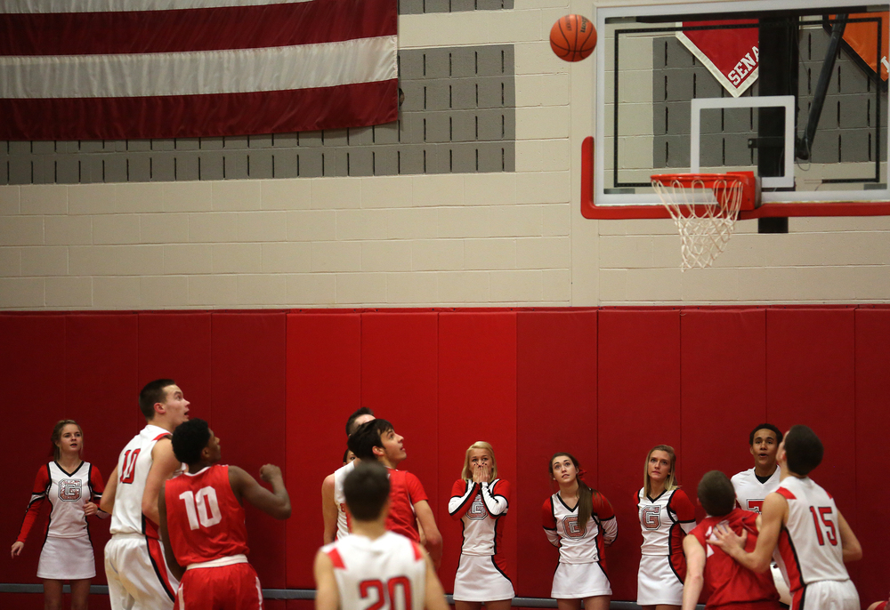 Glenwood player Cole Harper at far left watches as what turned out to be his game winning shot goes airborne moments before falling through the basket. Chatham Glenwood High School defeated Jacksonville High School 36-35 in boys basketball action at Glenwood High School Tuesday evening, Jan. 6, 2015. David Spencer/The State Journal-Register