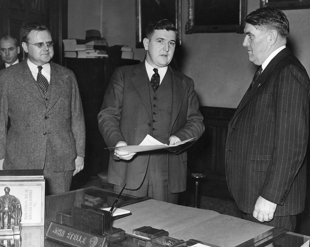 Gov. John Stelle, right, presents mourning proclamation to Michael Kinney, Oct. 7, 1940. It was Steele's first act as governor after Horner's death the previous day. File/The State Journal-Register governor; politics