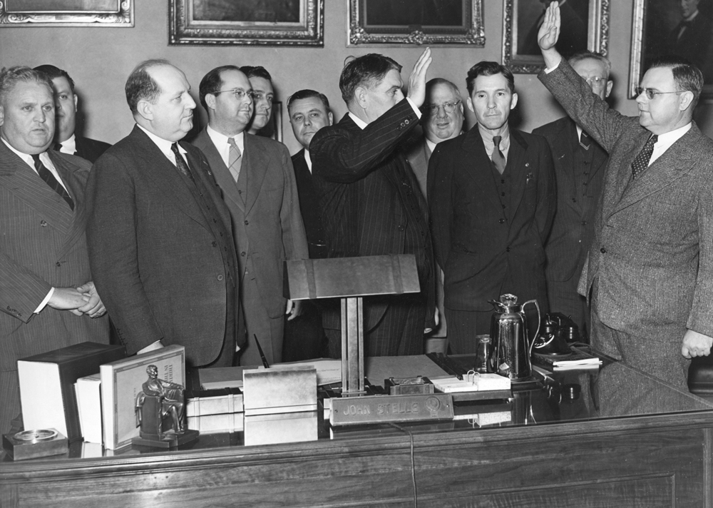 Circuit Judge W. Joe Hill administers the oath of office to Gov. John Stelle Oct. 7, 1940, following the death of Gov. Henry Horner. Stelle had served as Lt. Governor under Horner. File/The State Journal-Register politics; governor