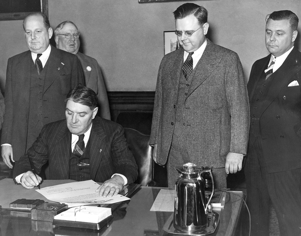 Gov. John Stelle signs mourning proclamation Oct. 7, 1940 for Gov. Henry Horner, who died the previous day. It was Stelle's first act as governor. File/The State Journal-Register