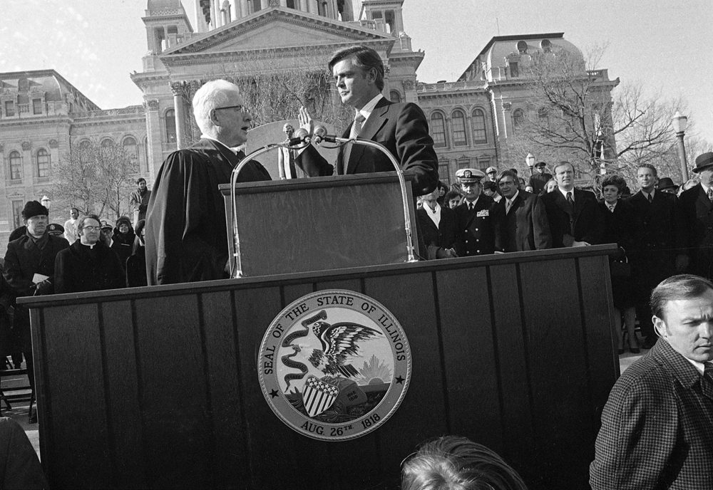 Supreme Court Justice Walter Schaefer administers the oath of office to Gov. Dan Walker on the steps of the Capitol Jan. 9, 1973. File/The State Journal-Register