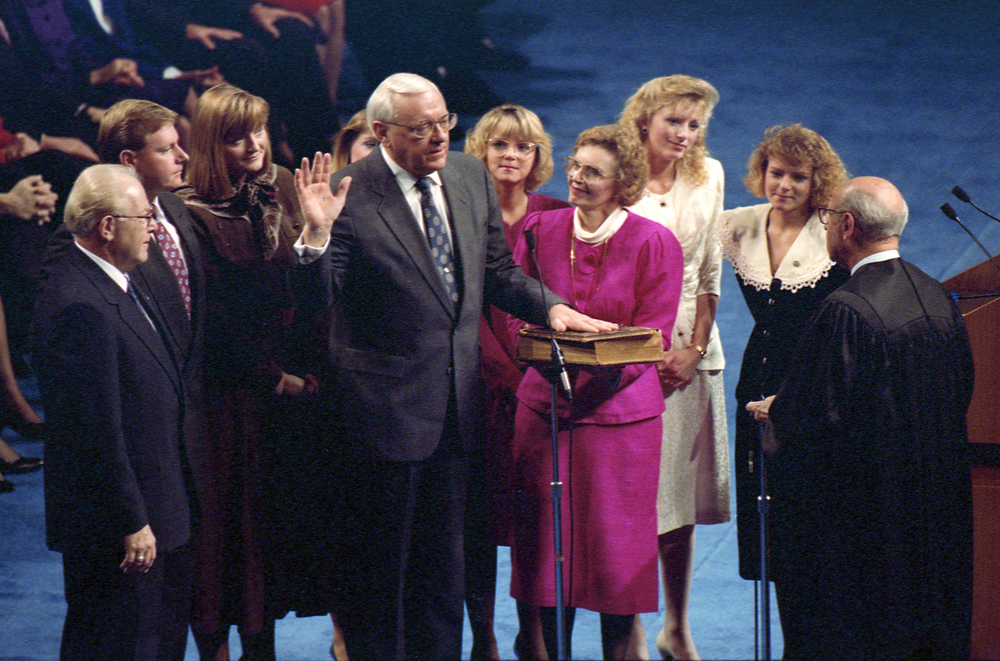 George Ryan, with wife Lura Lynn and family, is sworn in as Secretary of State at the Prairie Capital Convention Center, Jan. 14, 1991. File/The State Journal-Register