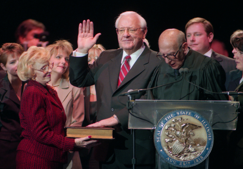 Gov. George Ryan surrounded by his family, including his wife Lura Lynn who holds the family's Bible, when he is inaugurated Jan. 11, 1999 at the Prairie Capital Convention Center. File/The State Journal-Register