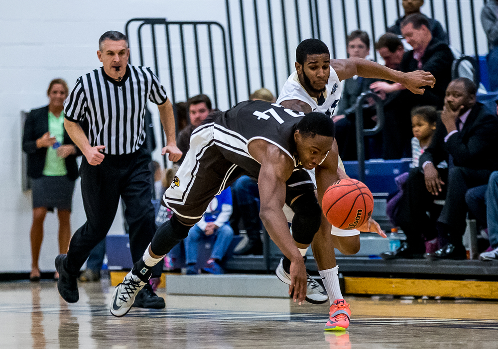 Quincy University's Godson Eneogwe (24) goes for a steal against University of Illinois Springfield's Davi Austin (2) in the first half at the UIS Athletic & Recreation Center, Thursday, Jan. 8, 2015, in Springfield, Ill. Justin L. Fowler/The State Journal-Register