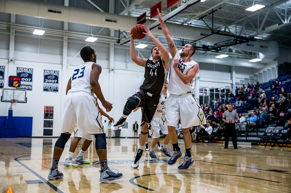 Quincy University's Josh Schaben (44) goes up for a shot against University of Illinois Springfield's Dylan Sparkman (54) in the first half at the UIS Athletic & Recreation Center, Thursday, Jan. 8, 2015, in Springfield, Ill. Justin L. Fowler/The State Journal-Register