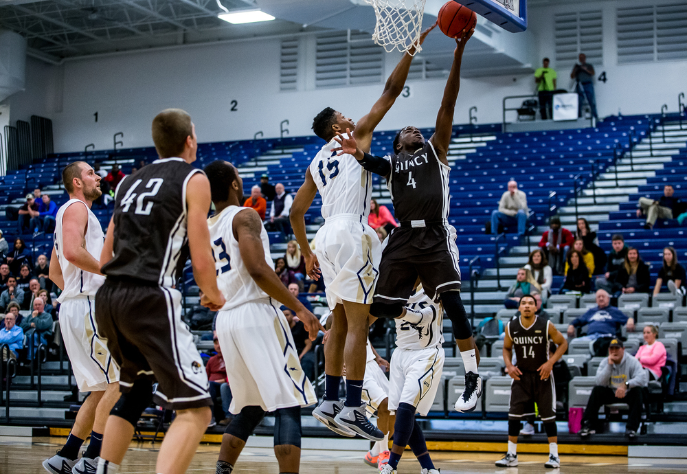 University of Illinois Springfield's Sammie Elem (15) blocks the shot of Quincy University's Thomas Jackson (4) in the first half at the UIS Athletic & Recreation Center, Thursday, Jan. 8, 2015, in Springfield, Ill. Justin L. Fowler/The State Journal-Register
