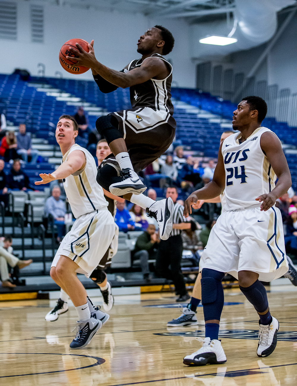 Quincy University's Thomas Jackson (4) goes up for a basket against University of Illinois Springfield's Wes Koral (3) and Jamall Millison (24) in the second half at the UIS Athletic & Recreation Center, Thursday, Jan. 8, 2015, in Springfield, Ill. Justin L. Fowler/The State Journal-Register