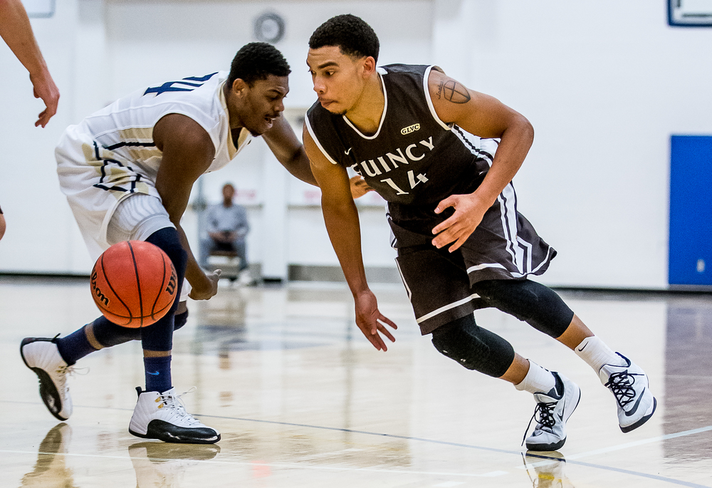 Quincy University's Herm Senor (14) goes for a loose ball knocked away by University of Illinois Springfield's Jamall Millison (24) in the second half at the UIS Athletic & Recreation Center, Thursday, Jan. 8, 2015, in Springfield, Ill. Justin L. Fowler/The State Journal-Register