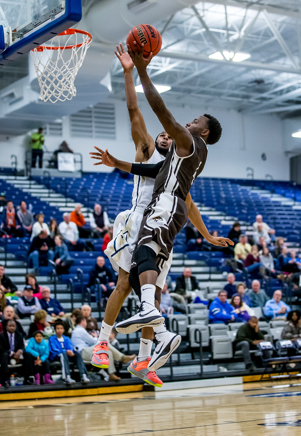 University of Illinois Springfield's Davi Austin (2) blocks a shot from Quincy University's Thomas Jackson (4) in the second half at the UIS Athletic & Recreation Center, Thursday, Jan. 8, 2015, in Springfield, Ill. Justin L. Fowler/The State Journal-Register