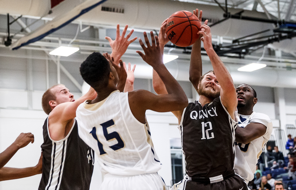Quincy University's Scott Hahn (12) pulls in a rebound against University of Illinois Springfield's Colin Blaydes (30) in the first half at the UIS Athletic & Recreation Center, Thursday, Jan. 8, 2015, in Springfield, Ill. Justin L. Fowler/The State Journal-Register