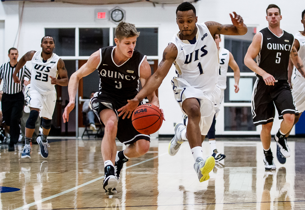 University of Illinois Springfield's Kentrell King (1) swats the ball away from Quincy University's Nate Des Jardins (3) in the first half at the UIS Athletic & Recreation Center, Thursday, Jan. 8, 2015, in Springfield, Ill. Justin L. Fowler/The State Journal-Register
