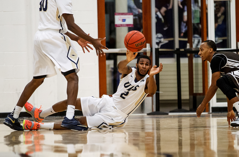 University of Illinois Springfield's Davi Austin (2) saves a loose ball as he passes it out to a teammate against Quincy University in the first half at the UIS Athletic & Recreation Center, Thursday, Jan. 8, 2015, in Springfield, Ill. Justin L. Fowler/The State Journal-Register