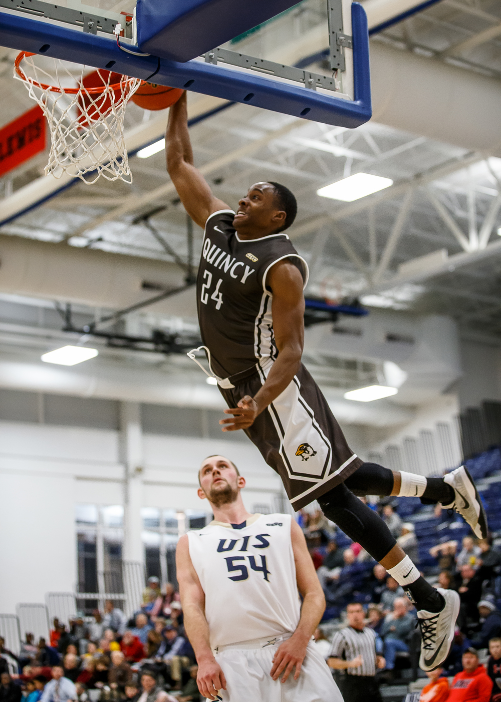 Quincy University's Godson Eneogwe (24) throws down a dunk in front of University of Illinois Springfield's Dylan Sparkman (54) in the first half at the UIS Athletic & Recreation Center, Thursday, Jan. 8, 2015, in Springfield, Ill. Justin L. Fowler/The State Journal-Register