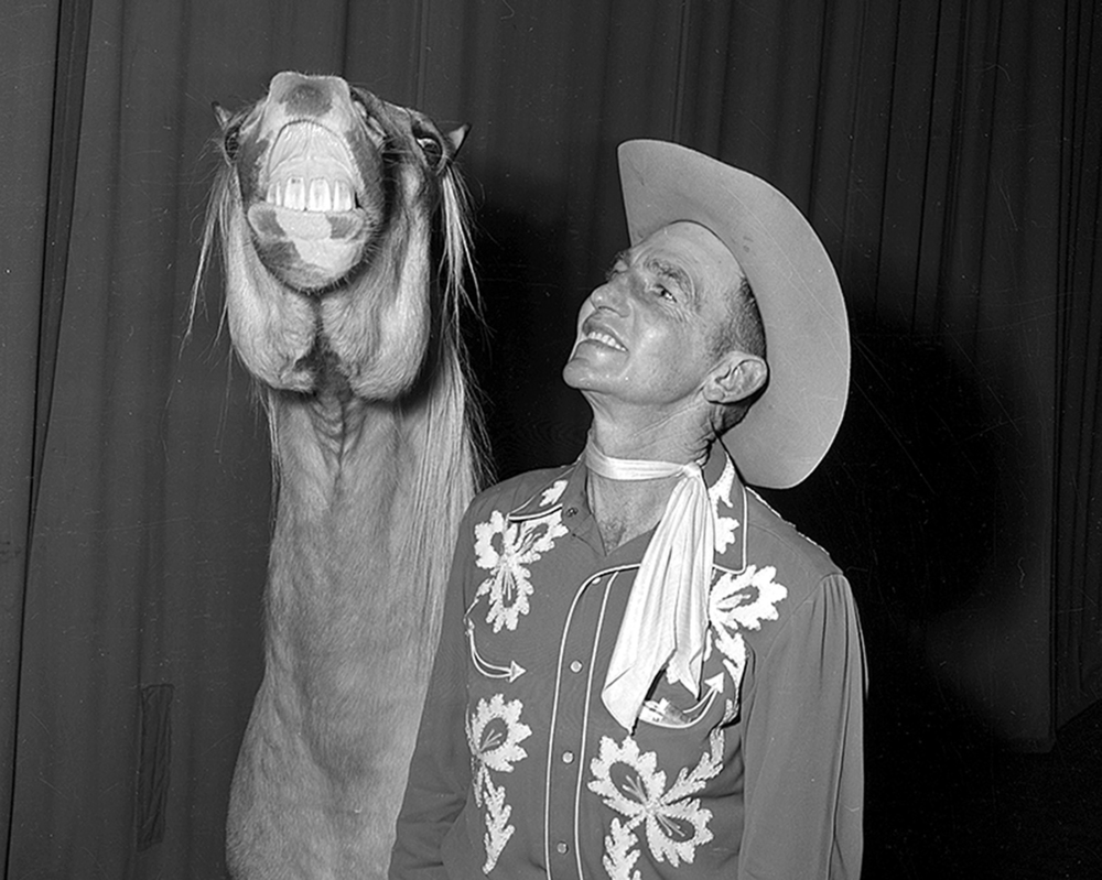 Pat Henry, Chickasha, Okla.,with trained horse during performance at the state armory, Jan. 25, 1955.