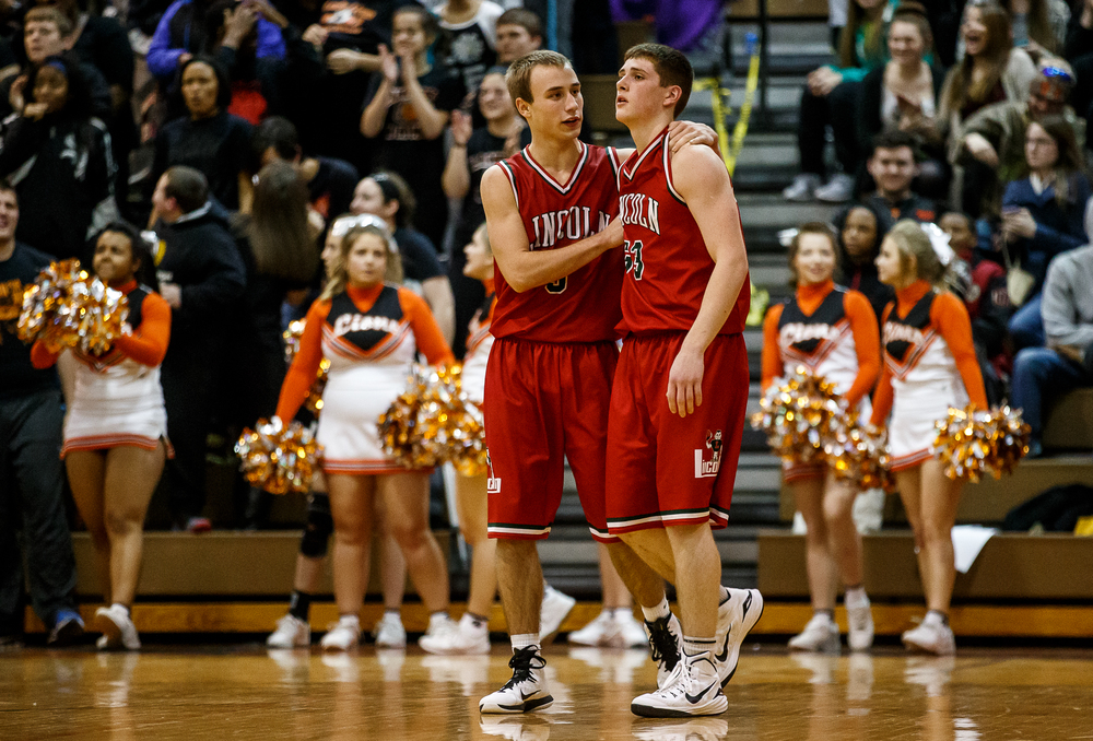 Lincoln's Aron Hopp (5) comes over to talk with Isaiah Bowers (33) after he fouled  Lanphier's Nick Patton (15) while shooting a three with 1.9 seconds left in the second half at Lober-Nika Gymnasium, Friday, Jan. 9, 2015, in Springfield, Ill. Justin L. Fowler/The State Journal-Register
