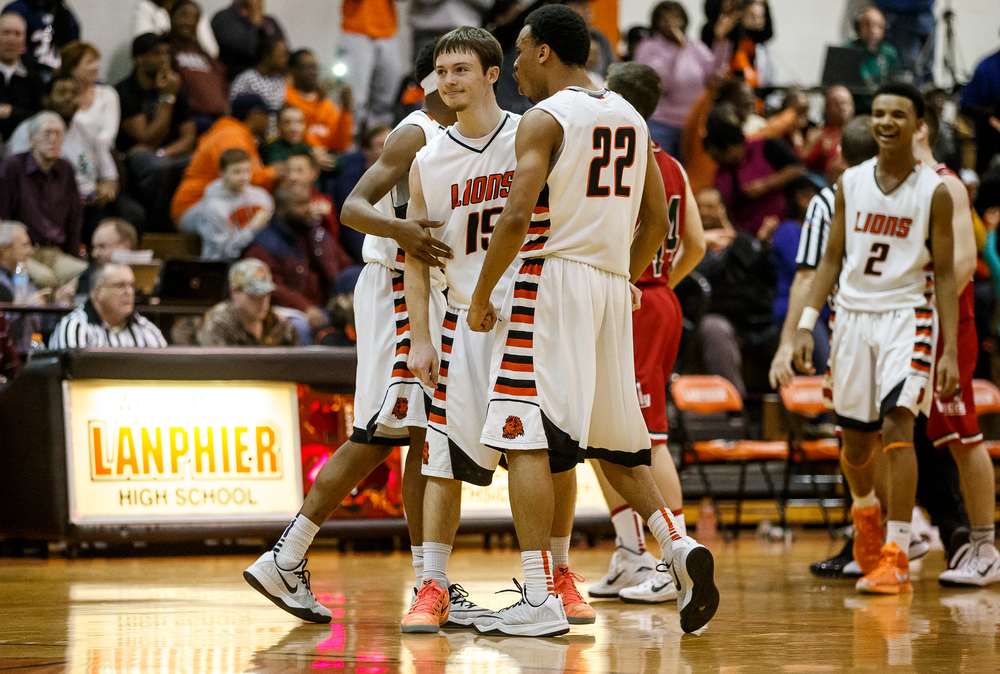 Lanphier's Nick Patton (15) is mobbed by his teammates after hitting three free throws from drawing a foul on Lincoln while shooting a three with 1.9 seconds left in the second half at Lober-Nika Gymnasium, Friday, Jan. 9, 2015, in Springfield, Ill. Justin L. Fowler/The State Journal-Register