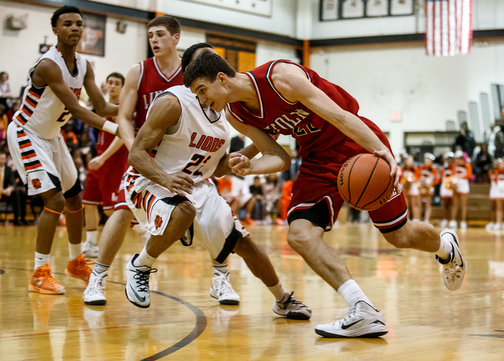Lincoln's Gavin Block (22) drives to the basket against Lanphier's Daryl Jackson (22) in the second half at Lober-Nika Gymnasium, Friday, Jan. 9, 2015, in Springfield, Ill. Justin L. Fowler/The State Journal-Register