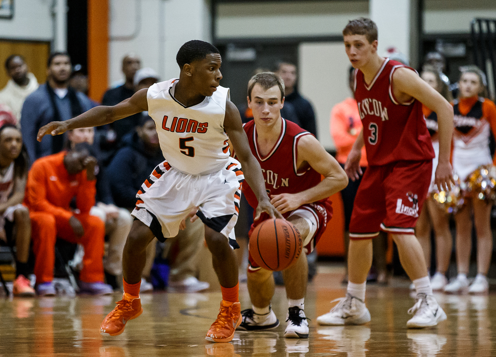 Lanphier's Xavier Bishop (5) spins around on Lincoln's Aron Hopp (5) as he works the perimeter in the second half at Lober-Nika Gymnasium, Friday, Jan. 9, 2015, in Springfield, Ill. Justin L. Fowler/The State Journal-Register