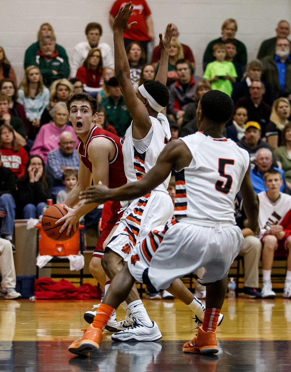 Lincoln's Payton Ebelherr (14) is swarmed by Lanphier's Aundrae Williams (23) as he tries to the pass the ball out in the second half at Lober-Nika Gymnasium, Friday, Jan. 9, 2015, in Springfield, Ill. Justin L. Fowler/The State Journal-Register