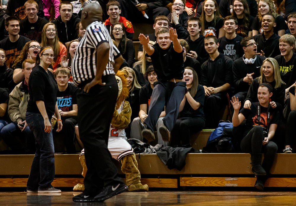 A Lanphier fan leaps into the air cheering on the Lions as they take on Lincoln in the second half at Lober-Nika Gymnasium, Friday, Jan. 9, 2015, in Springfield, Ill. Justin L. Fowler/The State Journal-Register