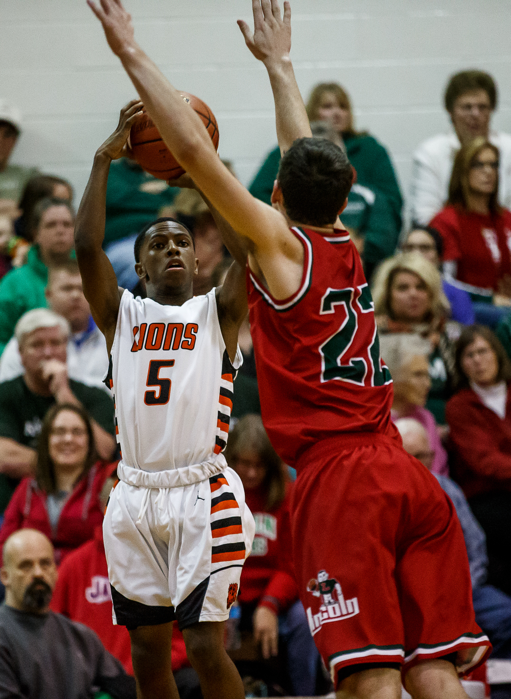 Lanphier's Xavier Bishop (5) fires off a shot in front of Lincoln's Gavin Block (22) in the first half at Lober-Nika Gymnasium, Friday, Jan. 9, 2015, in Springfield, Ill. Justin L. Fowler/The State Journal-Register