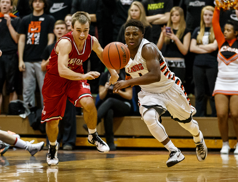 Lanphier's Yaakema Rose (1) and Lincoln's Aron Hopp (5) go after a loose ball in the second half at Lober-Nika Gymnasium, Friday, Jan. 9, 2015, in Springfield, Ill. Justin L. Fowler/The State Journal-Register