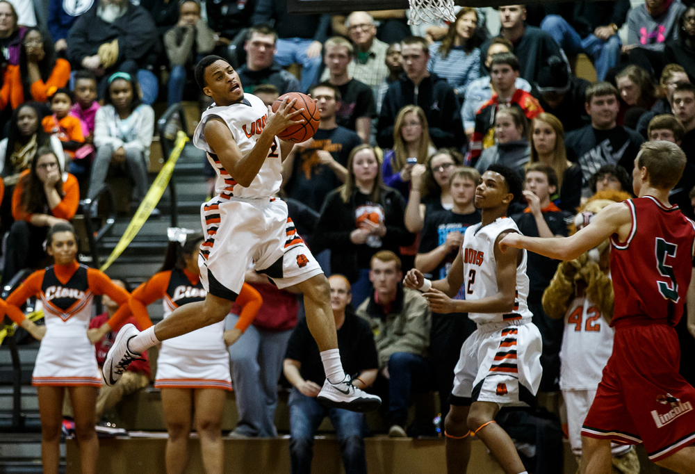 Lanphier's Daryl Jackson (22) comes down with defensive rebound against Lincoln in the first half at Lober-Nika Gymnasium, Friday, Jan. 9, 2015, in Springfield, Ill. Justin L. Fowler/The State Journal-Register