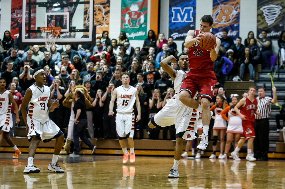 Lincoln's Gavin Block (22) pulls a pass out of the air against Lanphier's Cardell McGee (2) in the first half at Lober-Nika Gymnasium, Friday, Jan. 9, 2015, in Springfield, Ill. Justin L. Fowler/The State Journal-Register