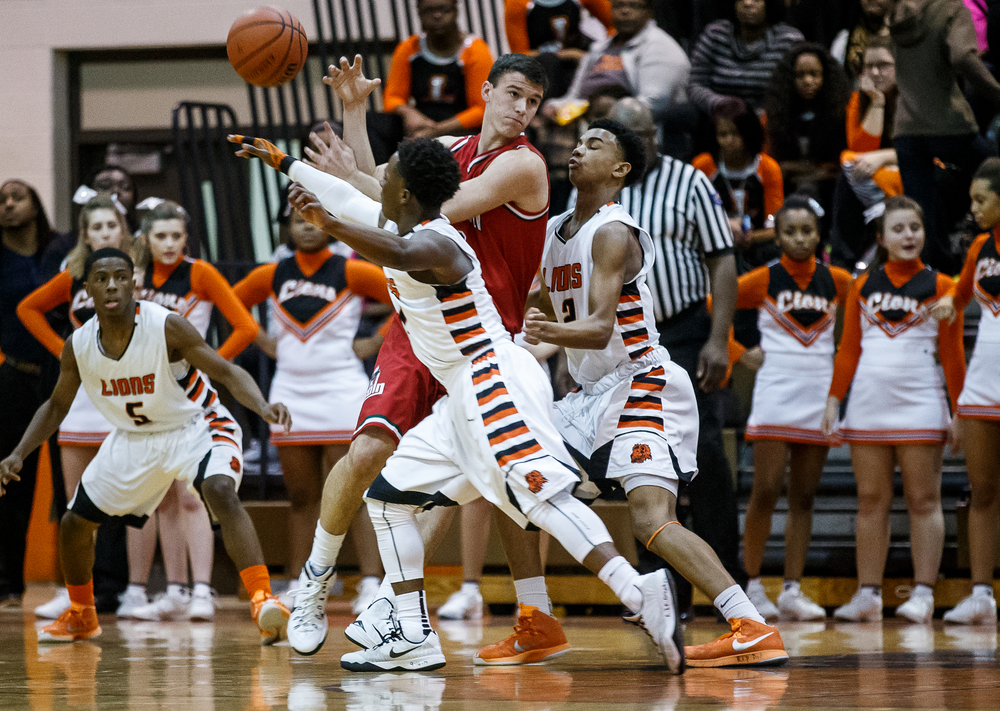 Lanphier's Yaakema Rose (1) knocks the ball away from Lincoln's Gavin Block (22) as he drives towards the basket in the first half at Lober-Nika Gymnasium, Friday, Jan. 9, 2015, in Springfield, Ill. Justin L. Fowler/The State Journal-Register