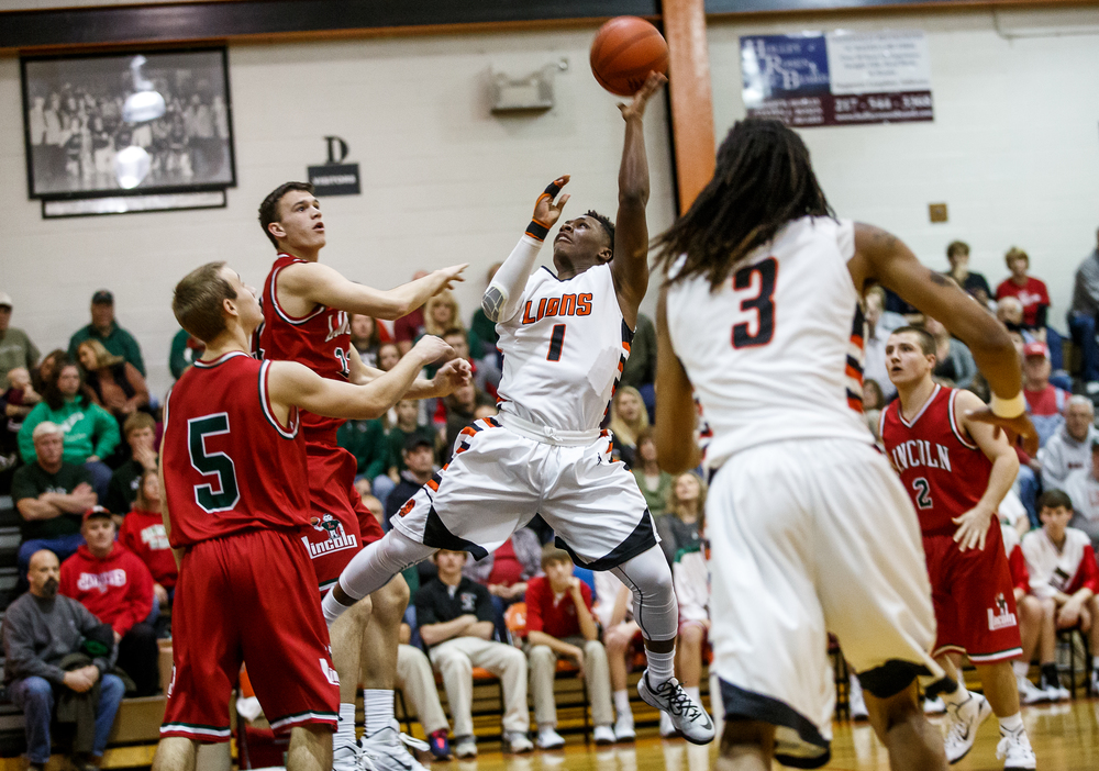 Lanphier's Yaakema Rose (1) goes up for a shot against Lincoln's Gavin Block (22) in the first half at Lober-Nika Gymnasium, Friday, Jan. 9, 2015, in Springfield, Ill. Justin L. Fowler/The State Journal-Register