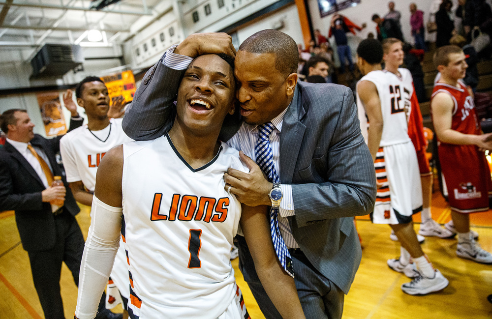Lanphier's Yaakema Rose (1) celebrates the Lions 40-35 victory over Lincoln with Lanphier head coach Blake Turner at Lober-Nika Gymnasium, Friday, Jan. 9, 2015, in Springfield, Ill. Justin L. Fowler/The State Journal-Register