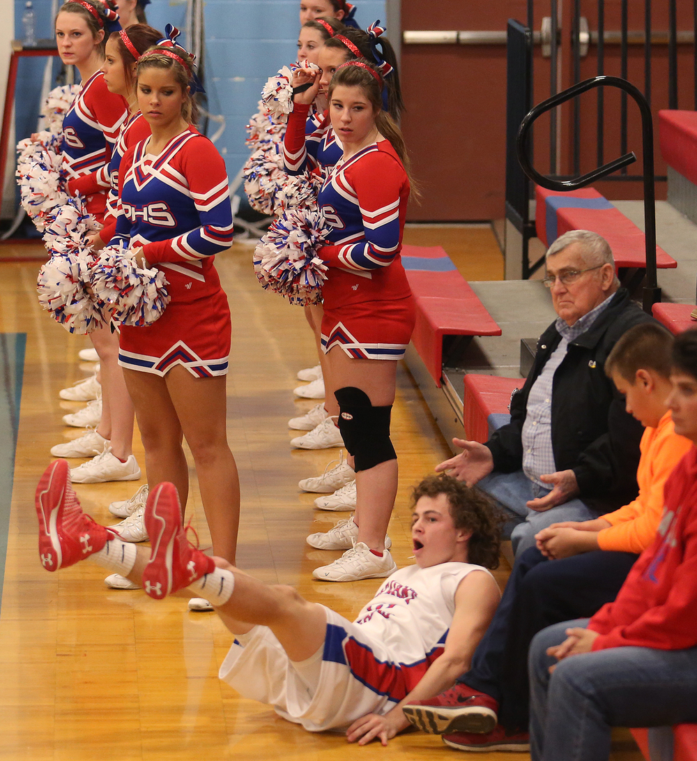 Plains player Cole Greer finds himself out of bounds after going after a loose ball. Pleasant Plains defeated Pawnee 50-44 in boys basketball action at Pleasant Plains High School on Friday evening, Jan. 9, 2015.  David Spencer/The State Journal-Register