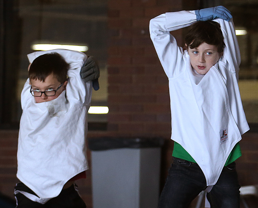 Nate Cox, left, and Ian Henehan stretch before a fencing class Jan. 4, 2015 at Nelson Center in Lincoln Park. Springfield�s Capitol Fencing Academy and the Springfield Park District sponsor the class. David Spencer/The State Journal-Register