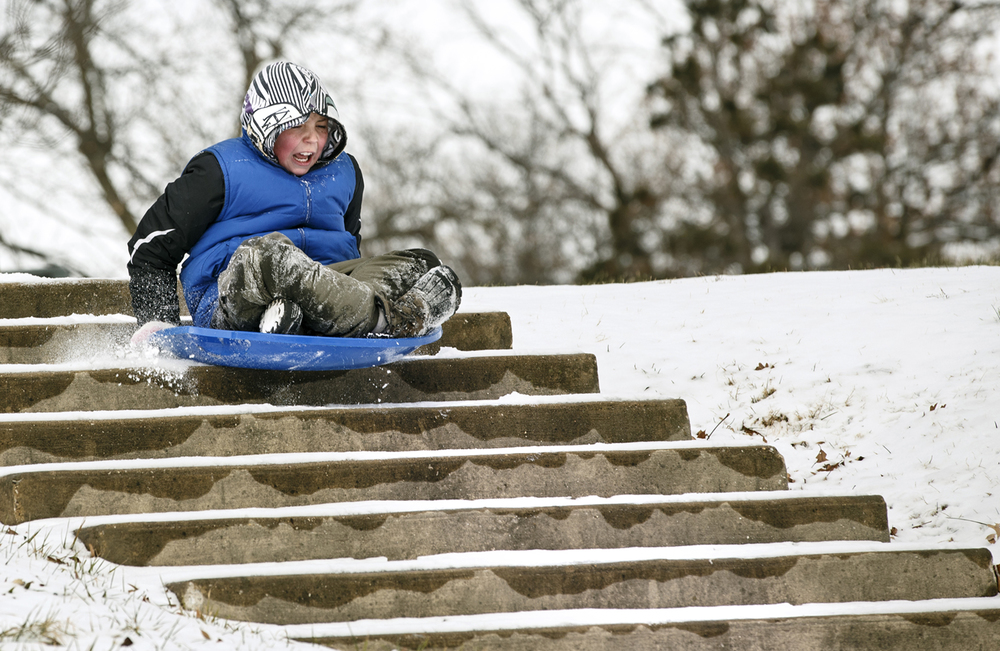 Although the nearby hill was covered in snow, Joseph Giganti took the stairs instead at Lincoln Park Tuesday, Jan. 6, 2015. Ted Schurter/The State Journal-Register