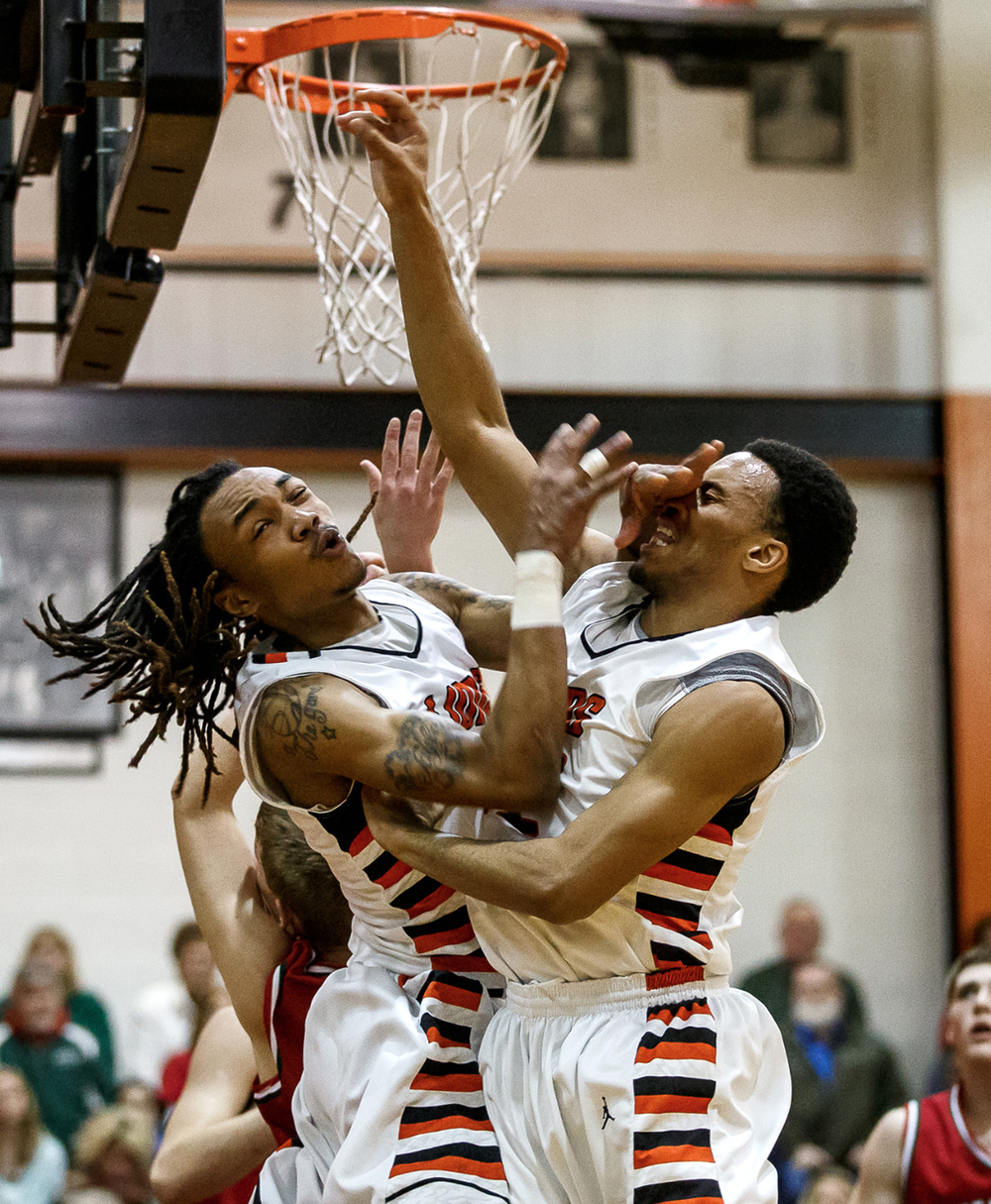 Lanphier's Aarin Thames (3) and Lanphier's Khiri Coleman (33) collide as they both go for a rebound against Lincoln in the first half at Lober-Nika Gymnasium, Friday, Jan. 9, 2015, in Springfield, Ill. Justin L. Fowler/The State Journal-Register